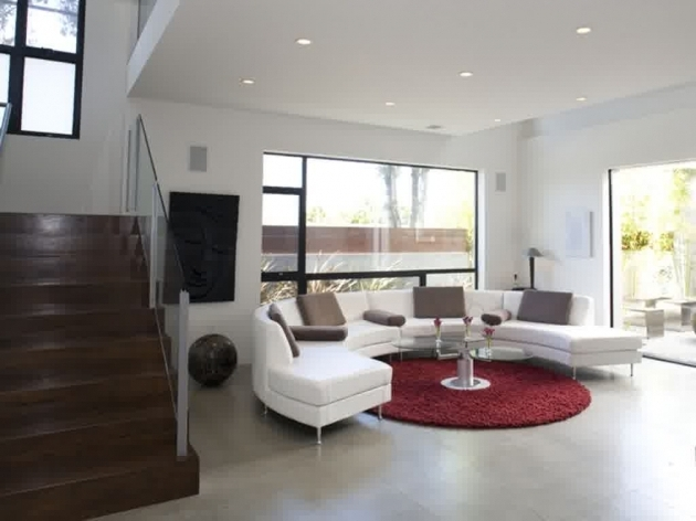 Large Round Area Rugs Living Room Mixed With Curved White Sofa And Dark Brown Stairs Image 30