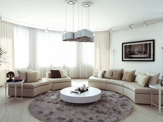 Large Round Area Rugs With Cream Leather Upholstery Sofa Mixed With Curve Large Glass Windows Image 47